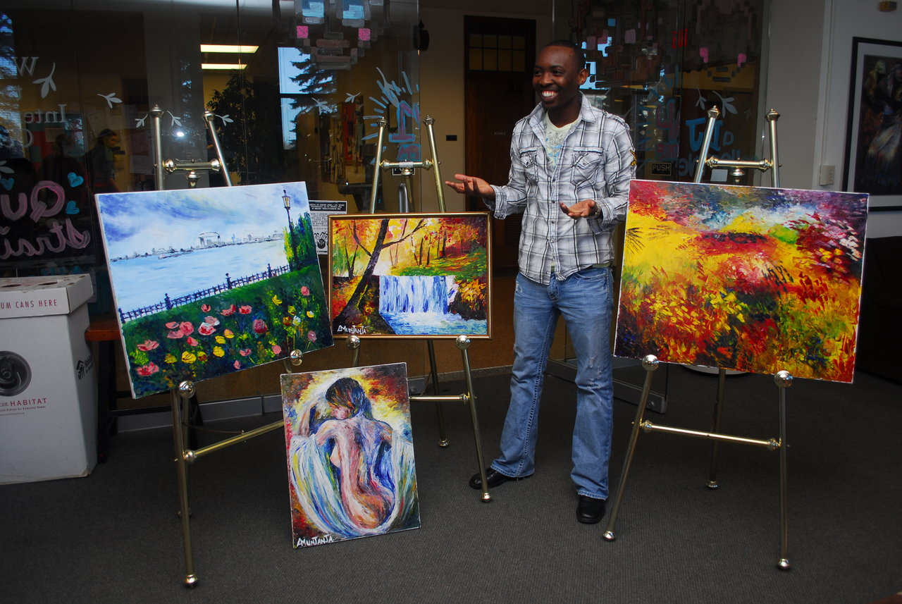 Lloyd Munjanja With Two Library Paintings