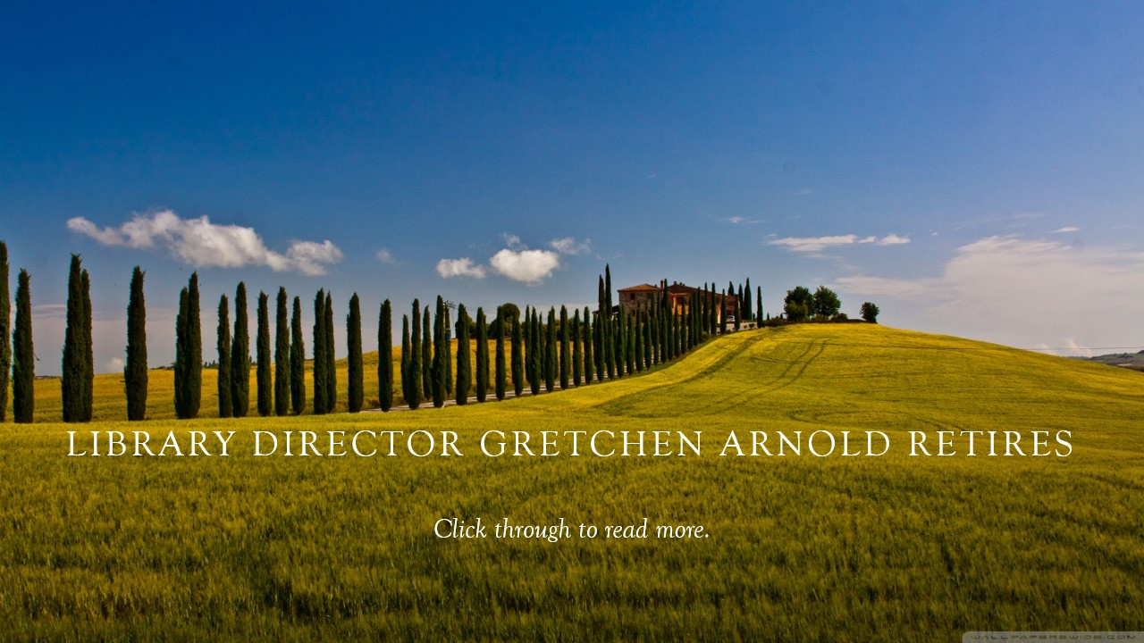 This banner has as its background a photo of the Italian countryside, with cypresses trees on either side of the road which leads to a large house. The text reads,