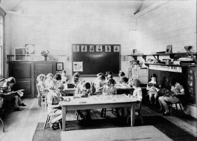 Photograph, children in a primary school classroom, circa 1930-1969 H2013.30/14