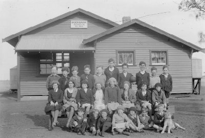 Photograph, group of students standing in front of Rockbank School, No. 919 H2008.122/365