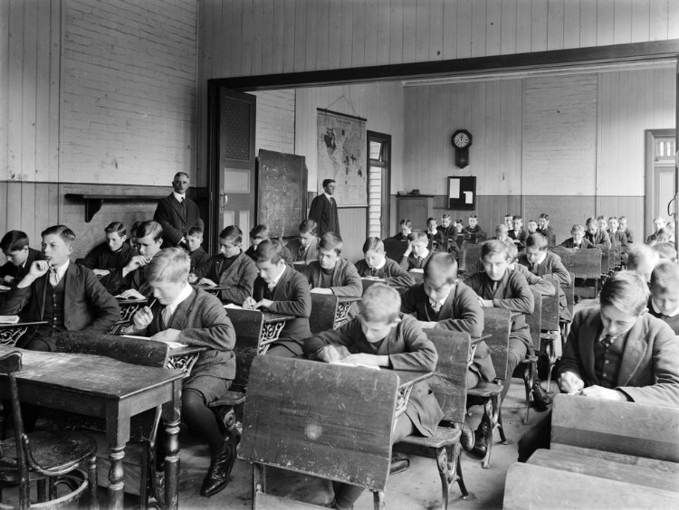 Photograph, classroom scene with students seated at desks, St. Thomas Grammar School H2004.61/208