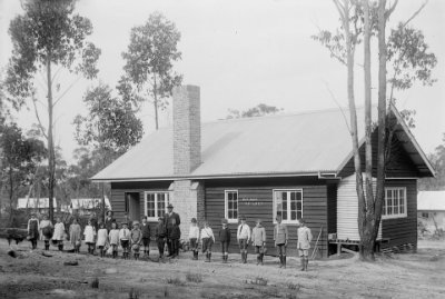 Photographs, First school pupils & master standing in front of school building (Yallourn) H2009.18/196