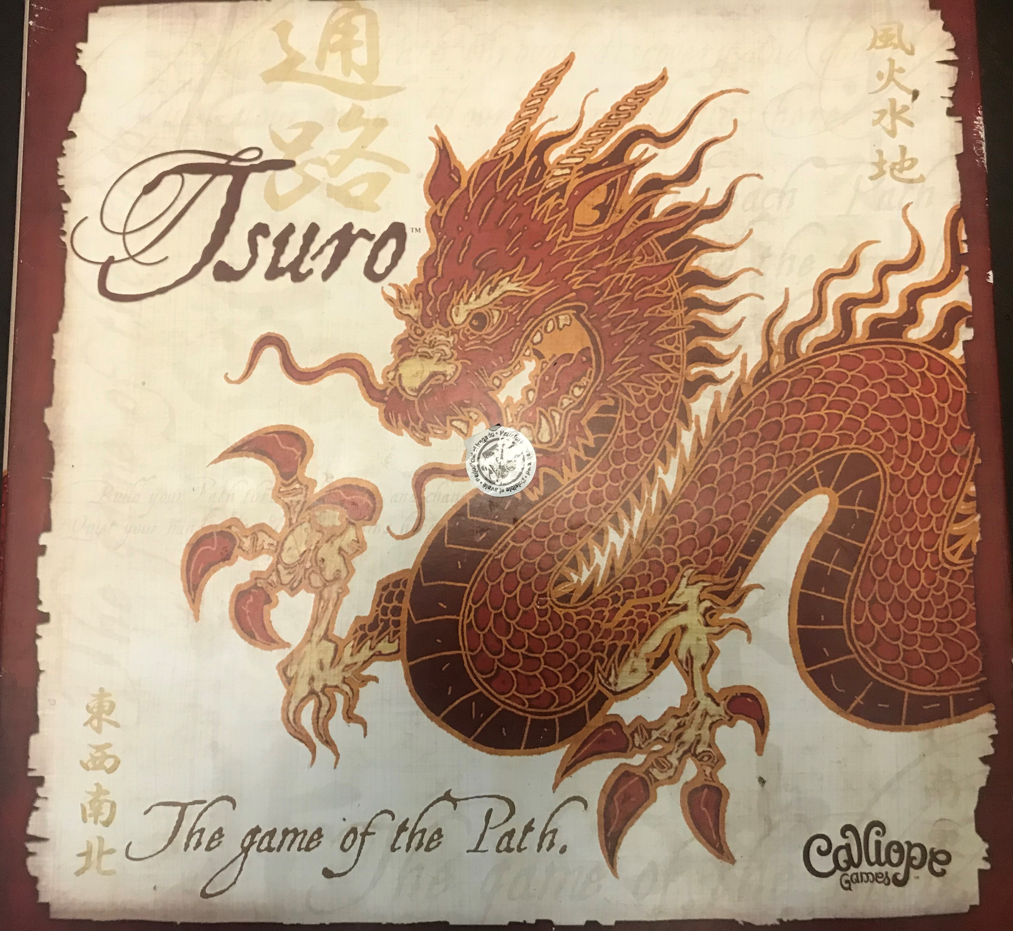 Image shows a red dragon. Text says: Tsuro the game of the path. Calliope games