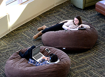 Students studying in bean bag chairs