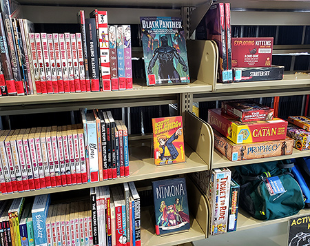 shelf with graphic novels and board games