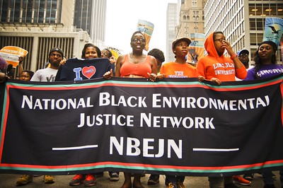 Protestors marching with a sign that says National Black Environmental Justice Network
