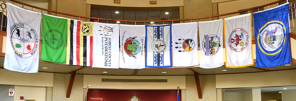 Flags from tribes of Wisconsin hanging in the Edgewood College lobby