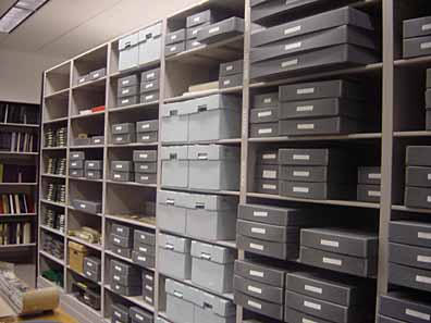 The archival boxes on shelves that make up the Manhattan College Archives