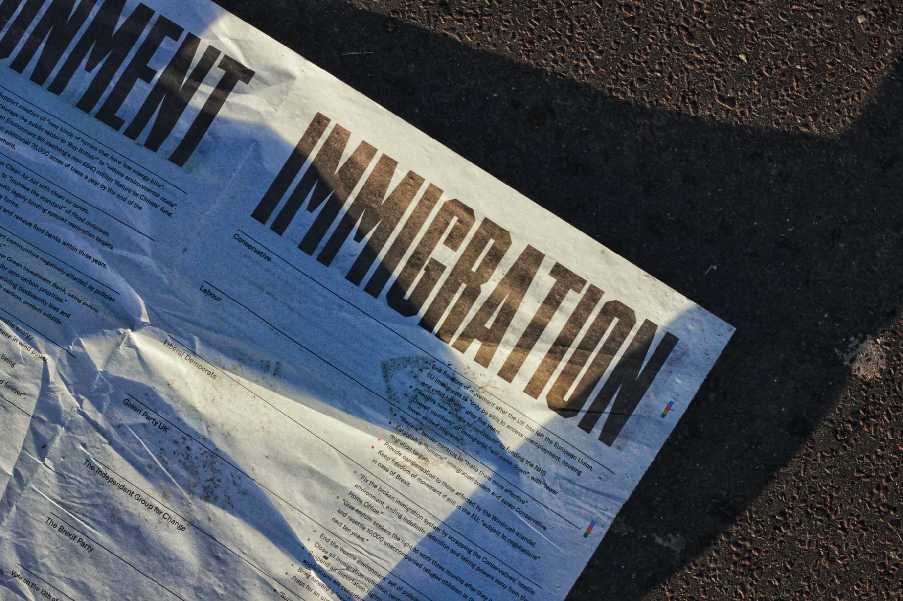 Picture of front of newspaper with the word Immigration