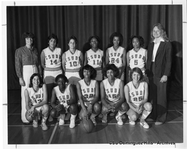 women in basketball uniforms with coaches