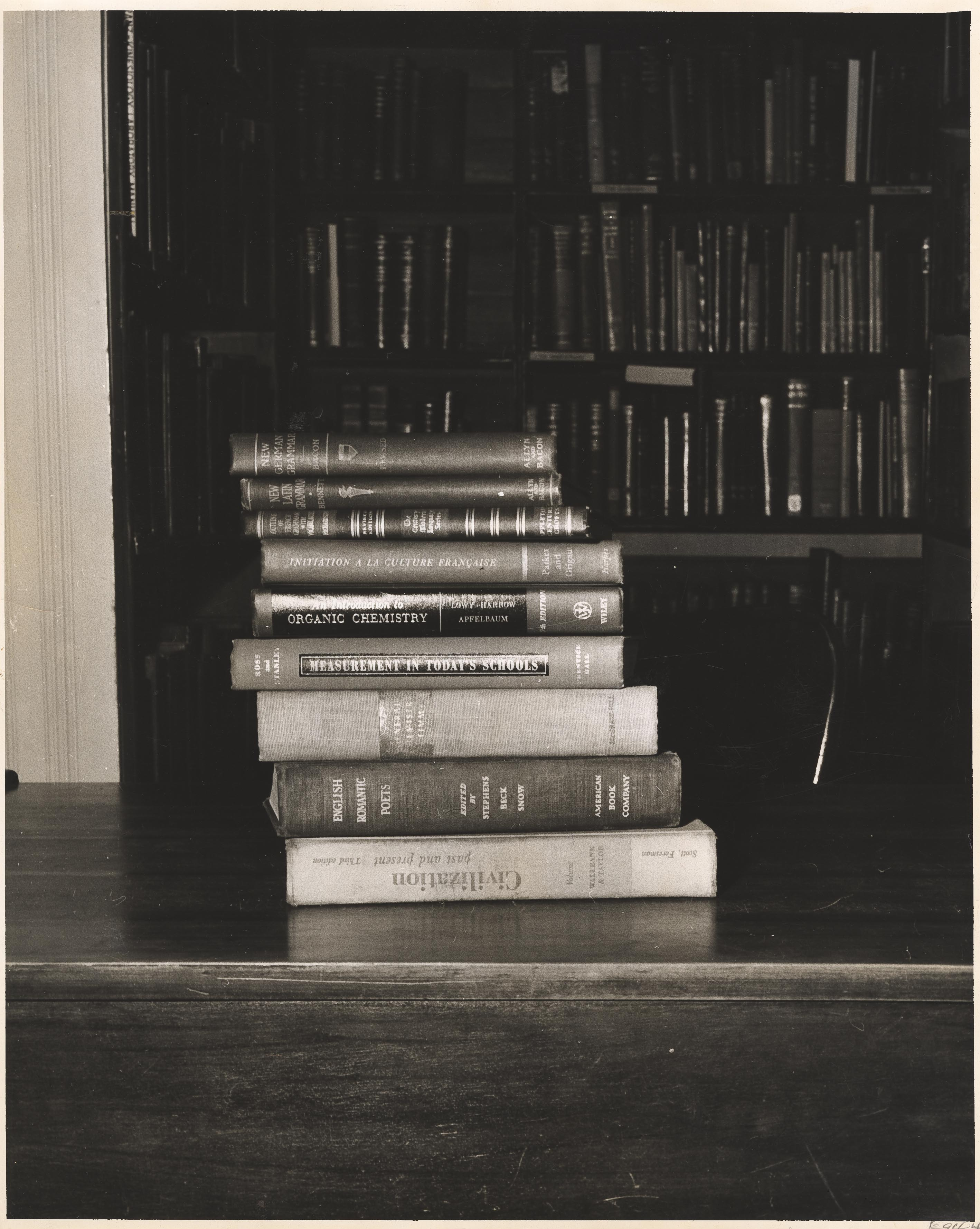 Books stacked on a table in Towell Library, built circa 1856, College of Charleston.