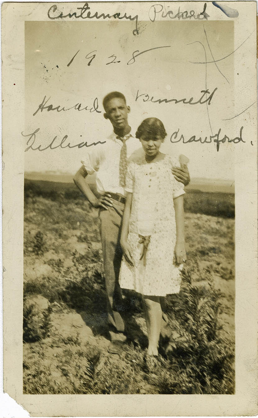 An African American couple pose for photograph in unidentified location in the year 1928.