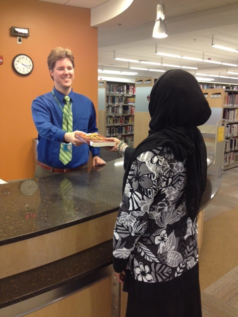 Friendly librarian helping a student