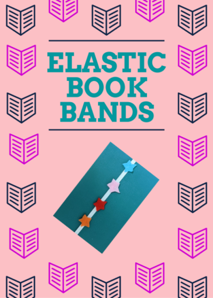 Image of a notebook adorned with an elastic band featuring colorful hearts.