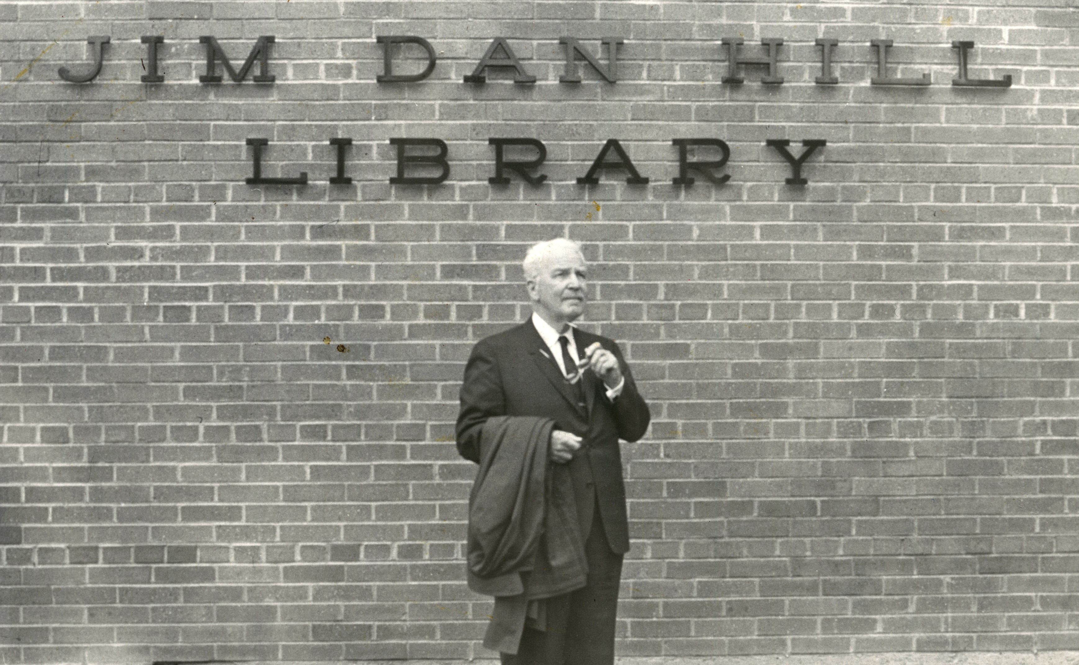 Jim Dan Hill in front of the library.