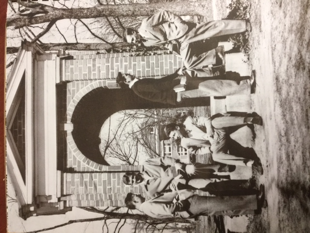 black and white photo of the well with students standing around it