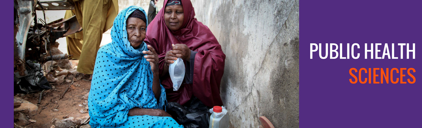 Color photo of two women drinking water in Somalia