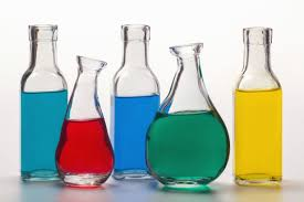 chemistry beakers with colored water