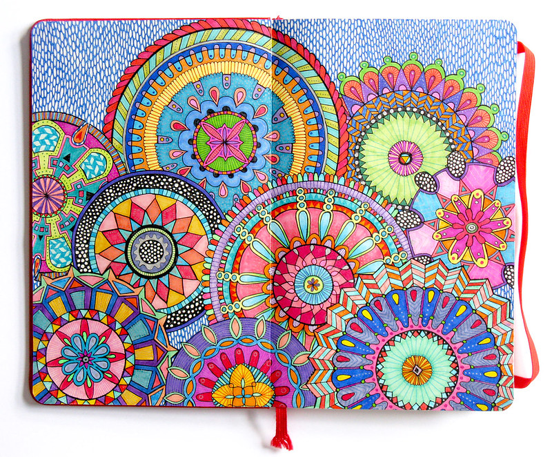 journal with multicolored mandalas