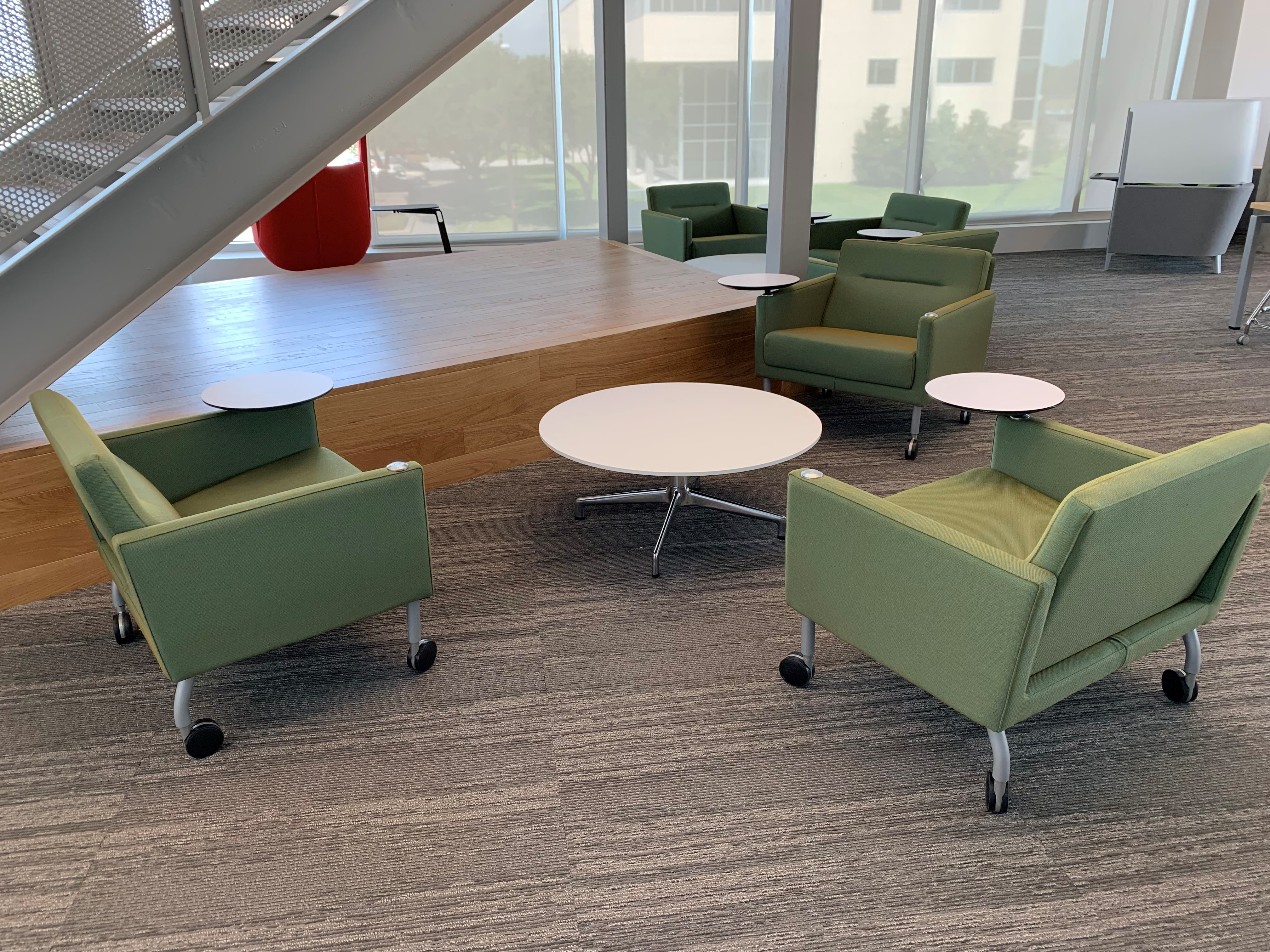 four green lounge chairs