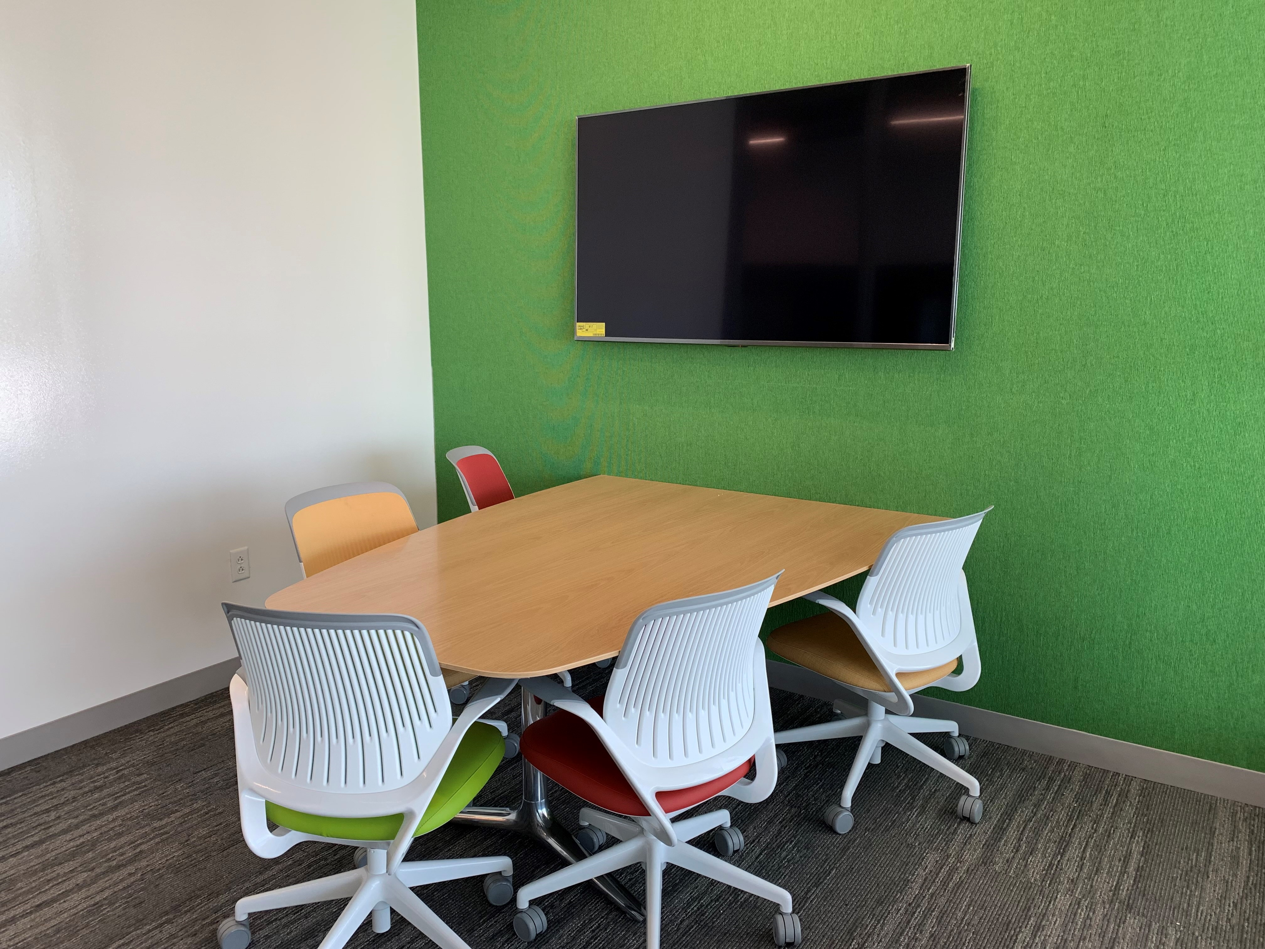 study room with green wall table and chairs