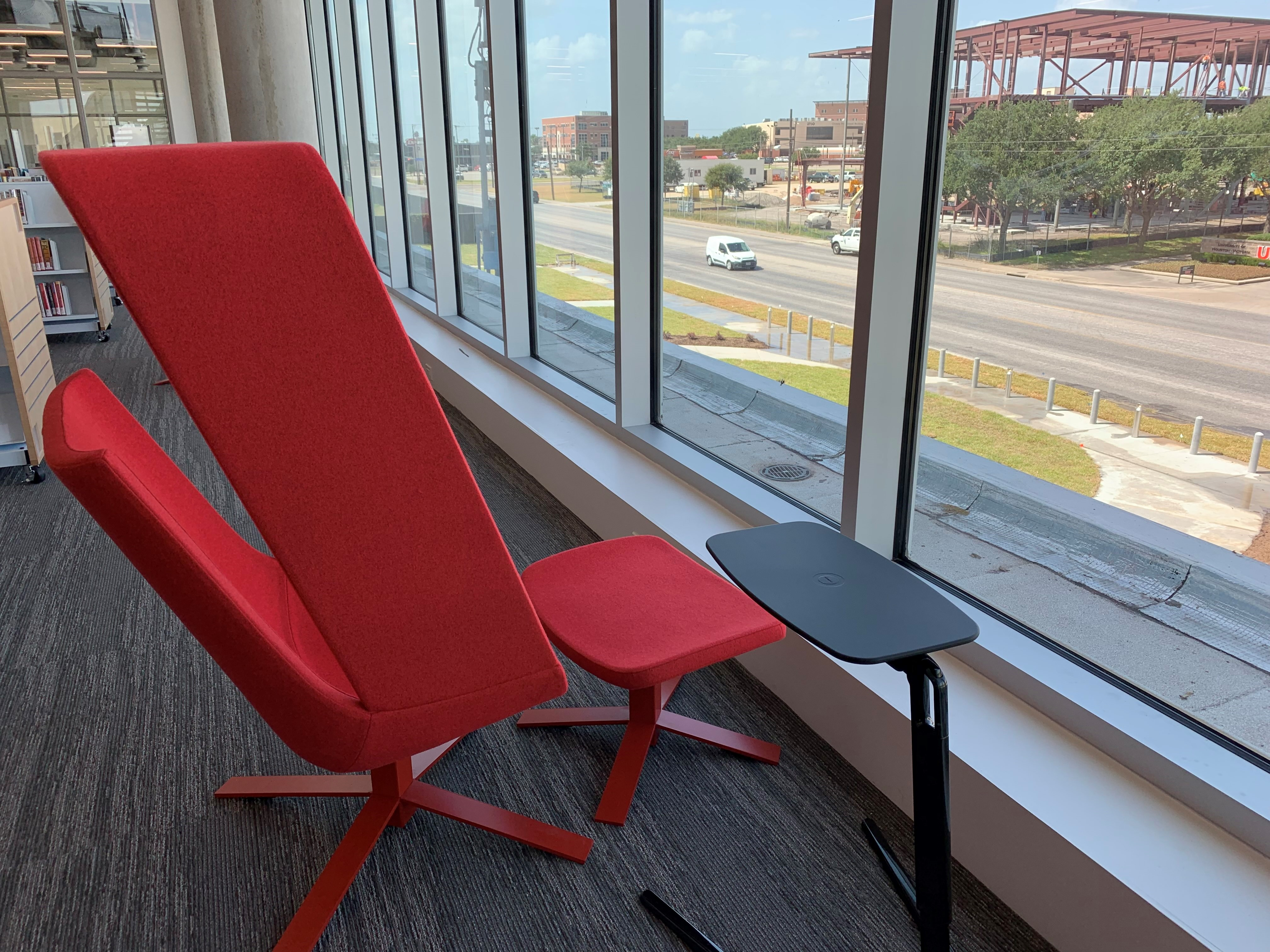 red chair next to a window