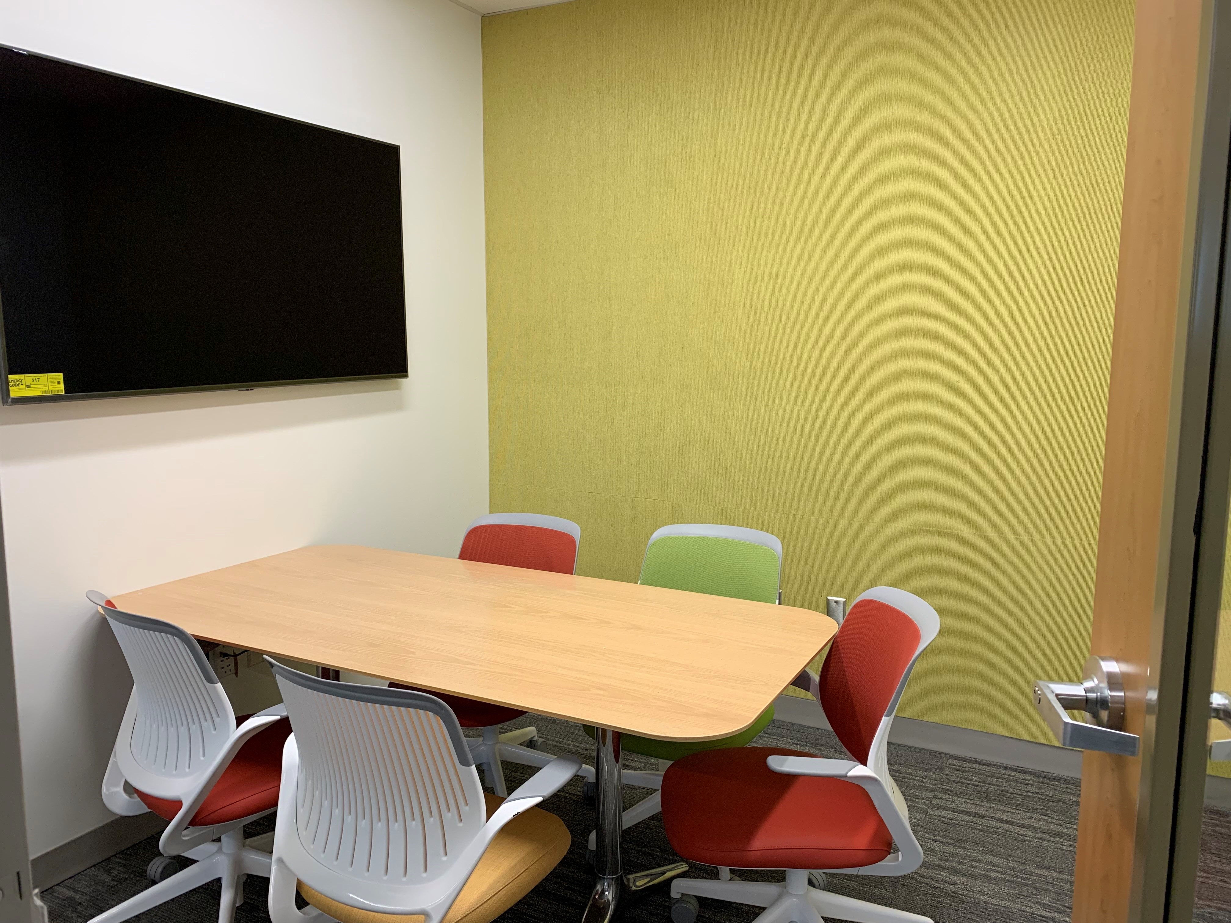 study room with yellow walls table and chairs