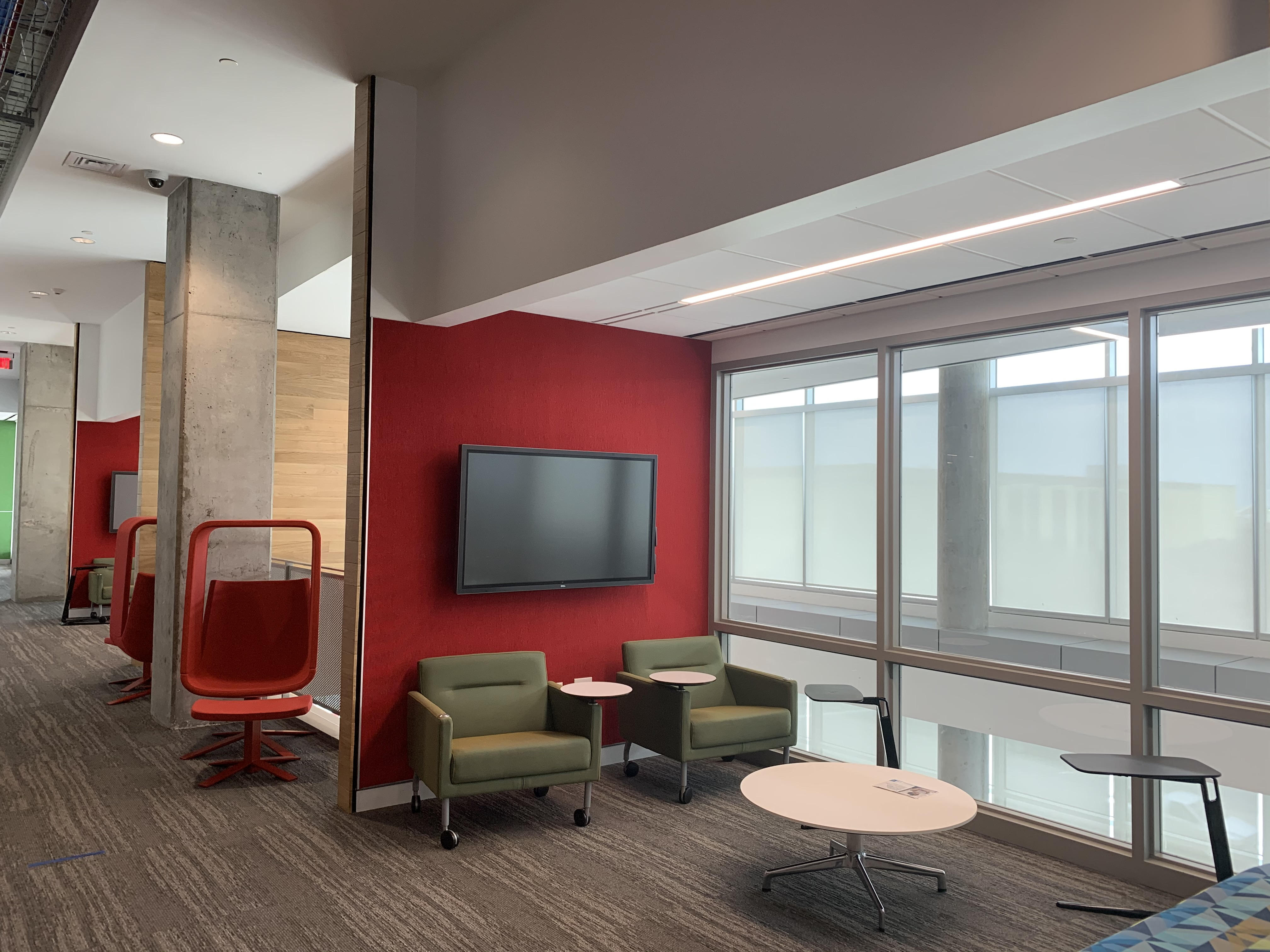 study area with red wall and variety of chairs