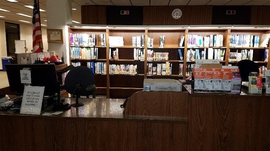 Highline Library Circulation Desk crowded with textbook reserves and other resources