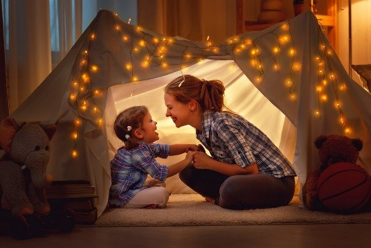 Mother and son in indoor tent