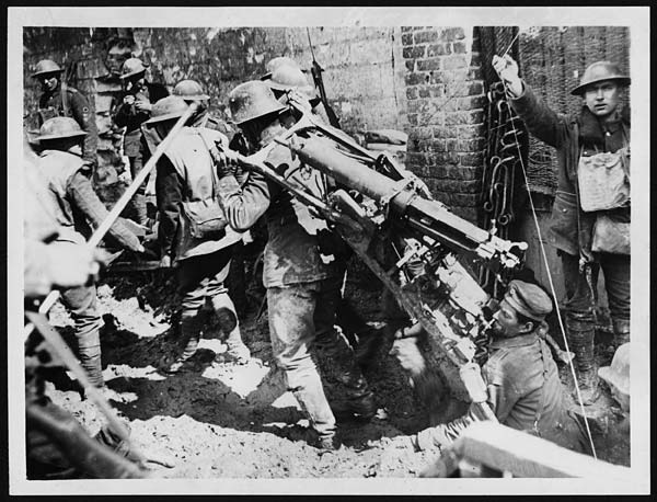 Boche Machine Gun Crew Captured, Bringing in Their Own Gun