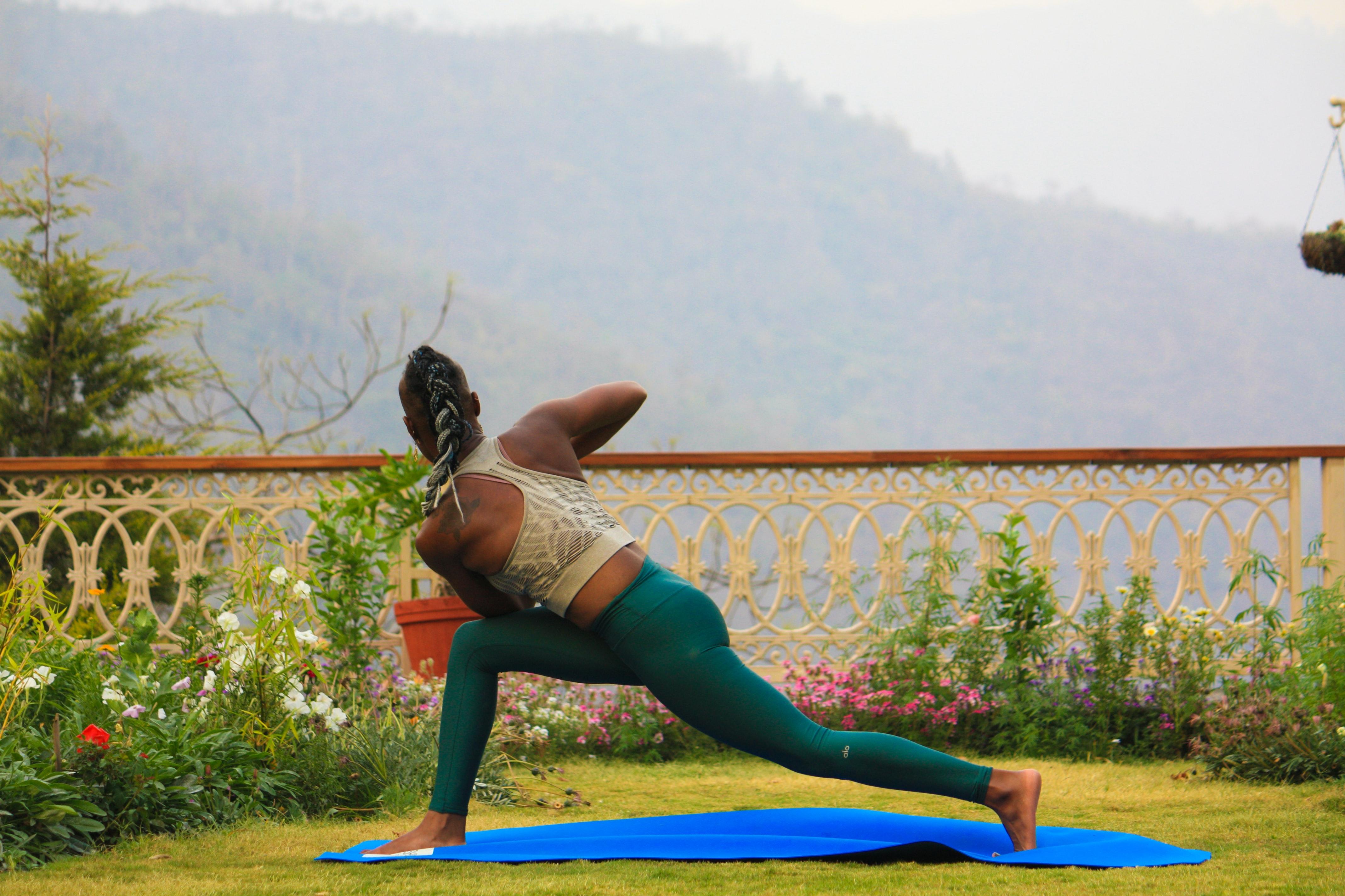 Black woman doing yoga outside