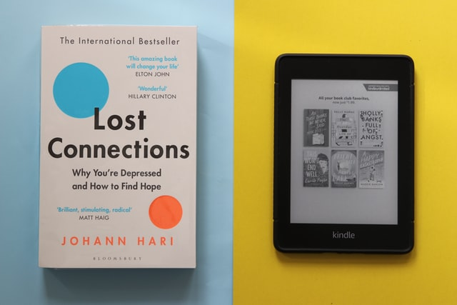 Picture of a book and an ereader tablet side by side