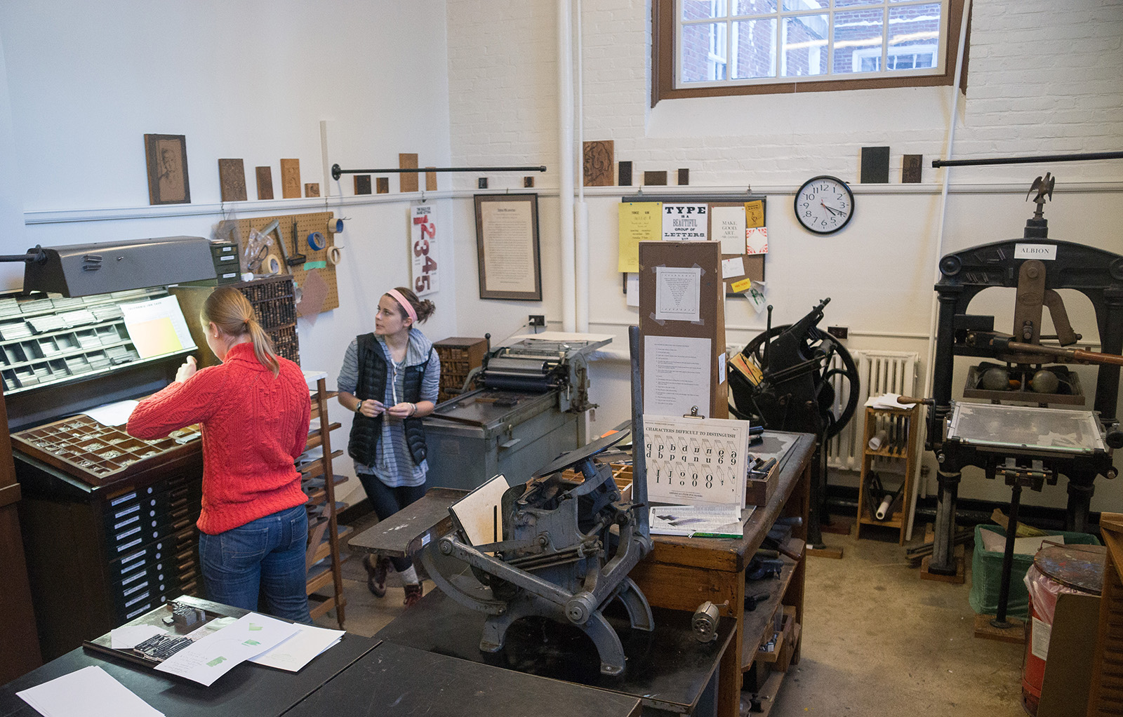 Students working in the Letterpress Studio with presses and metal type