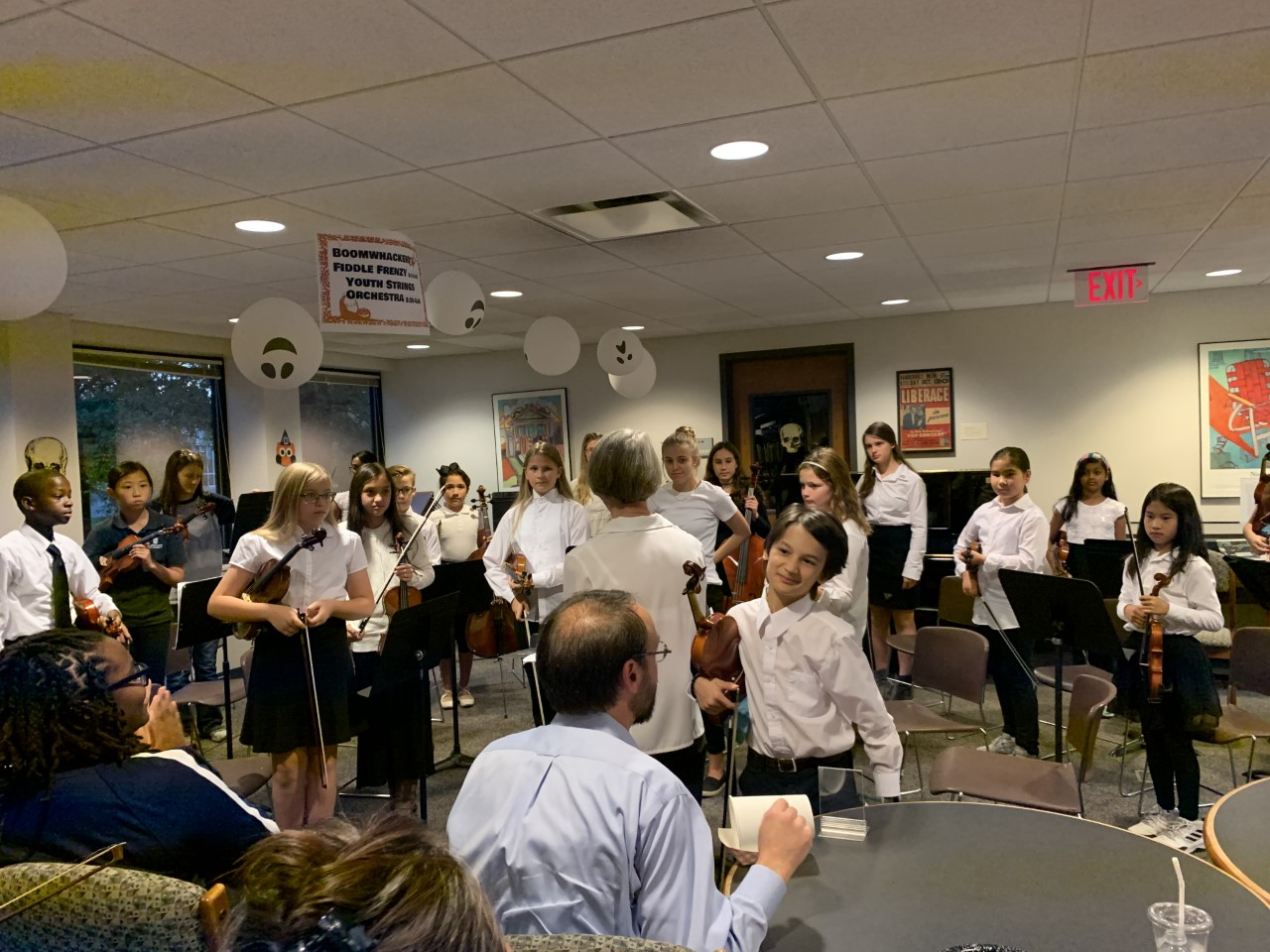 The Youth Strings Orchestra performs in the Music Library during the Halloween Open House on Tuesday, Oct. 29, 2019.