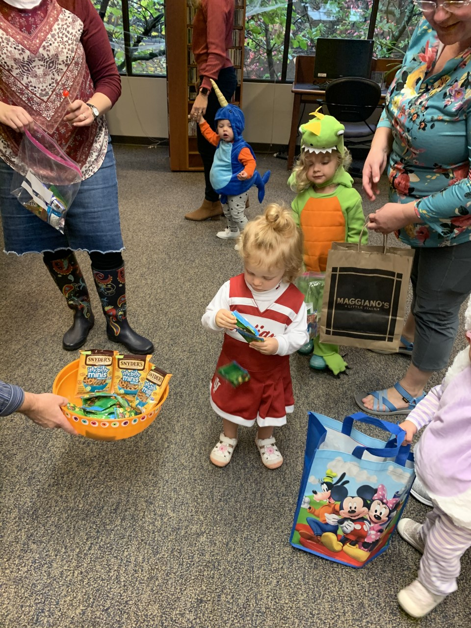 Blair's Kindermusik class drops by the Music Library for trick or treating in October, 2019.