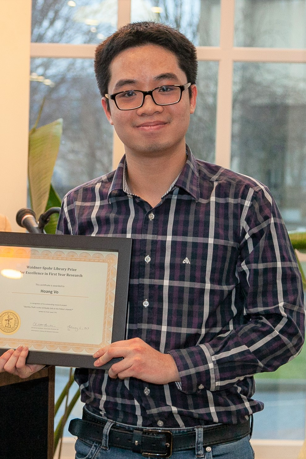 Hoang Vo with his certificate