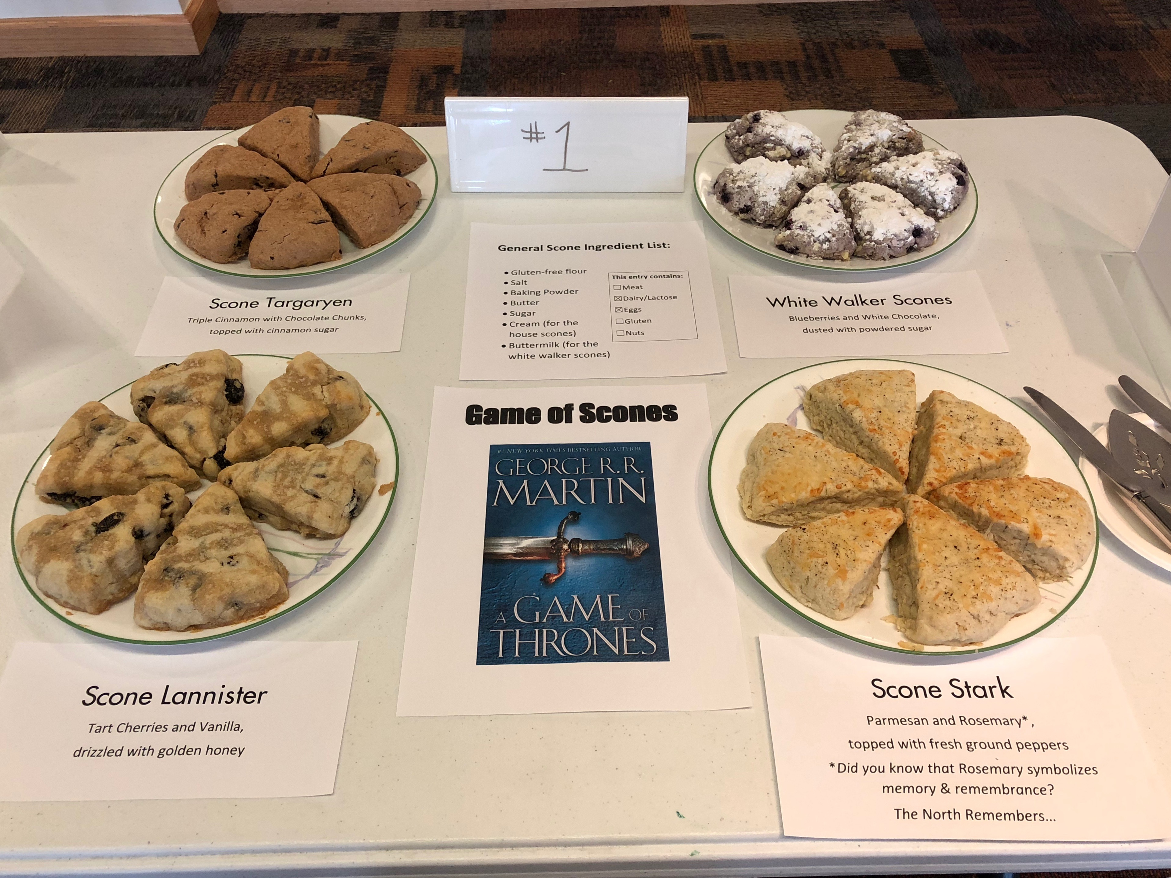 Scone Lannister (cherries, vanilla, & honey); Scone Targaryen (triple cinnamon with chocolate chunks); Scone Stark (parmesan and rosemary); and White Walker Scones (blueberry and white chocolate) compete for the throne in this tribute to Game of Thrones.