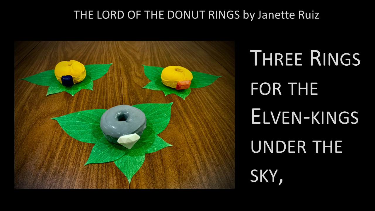 Janette baked donuts and coated them in colored chocolate, and arranged them based on the verses of the poem. Three Rings for the Elven-kings under the sky...