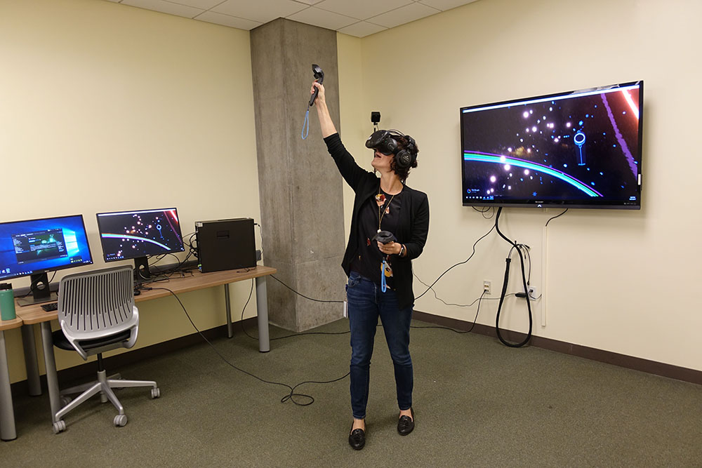 VizLab with person using VR.