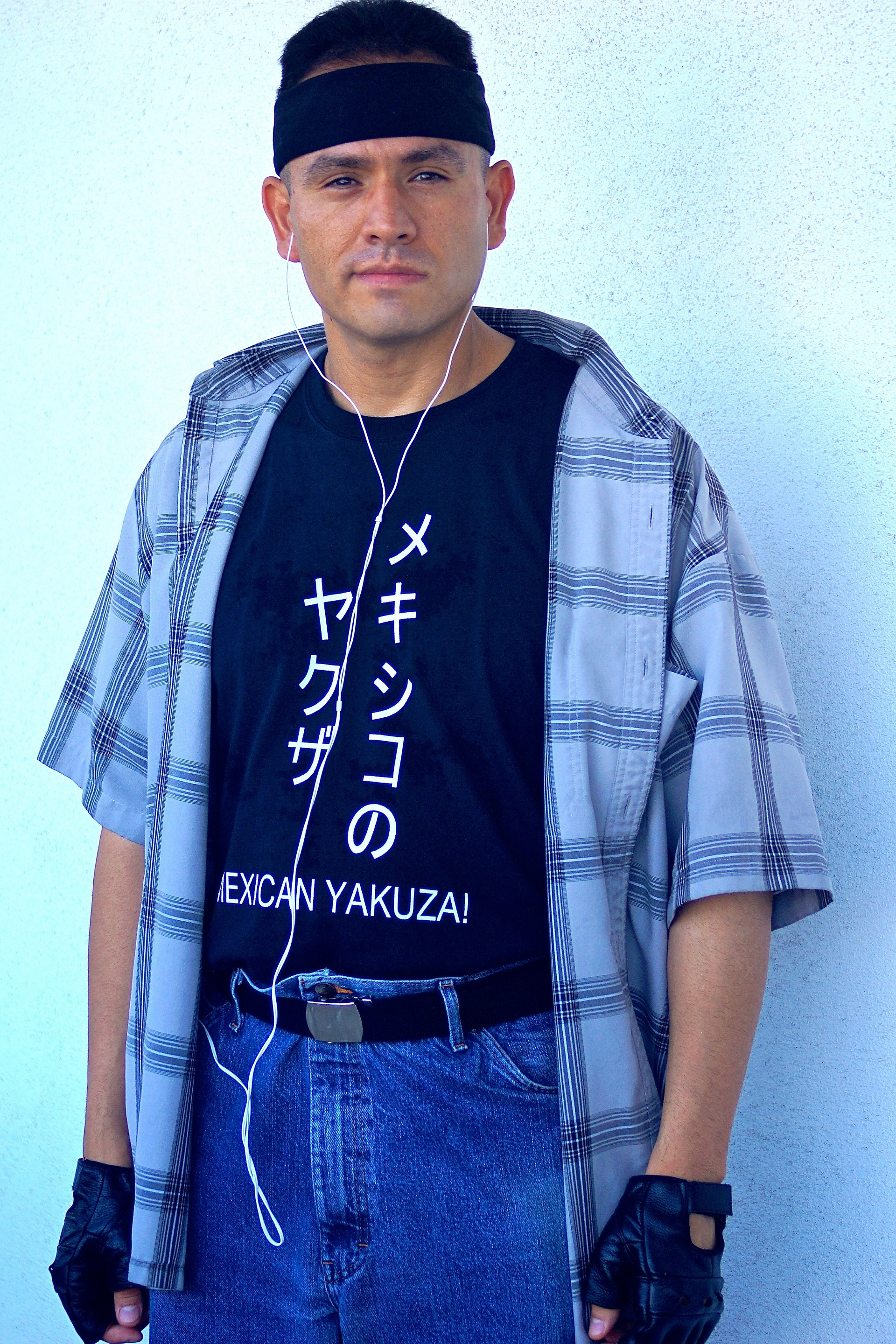 Man in shirt with flannel and headband.