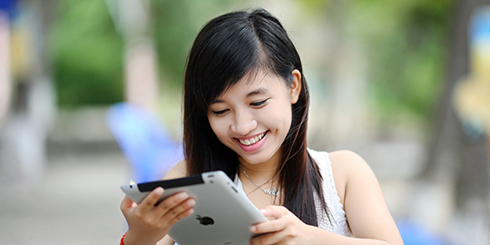 Woman using tablet outside
