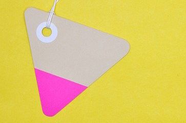 Clothing tag on yellow background