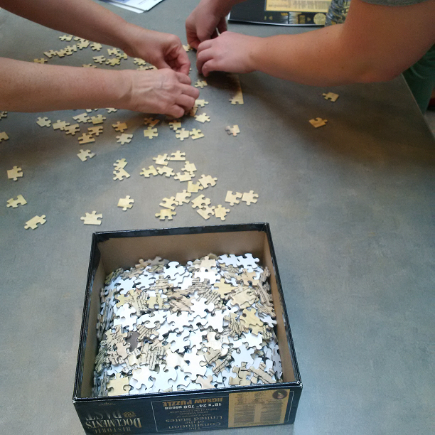 Constitution jigsaw puzzle: working together to put the puzzle together