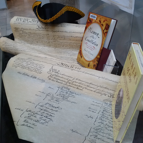 Constitution on parchment, with books about the Constitution