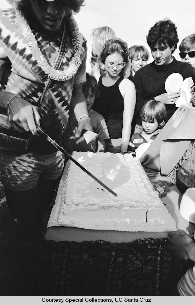 students cutting a cake