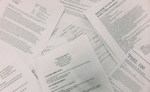 A pile of printed course syllabi