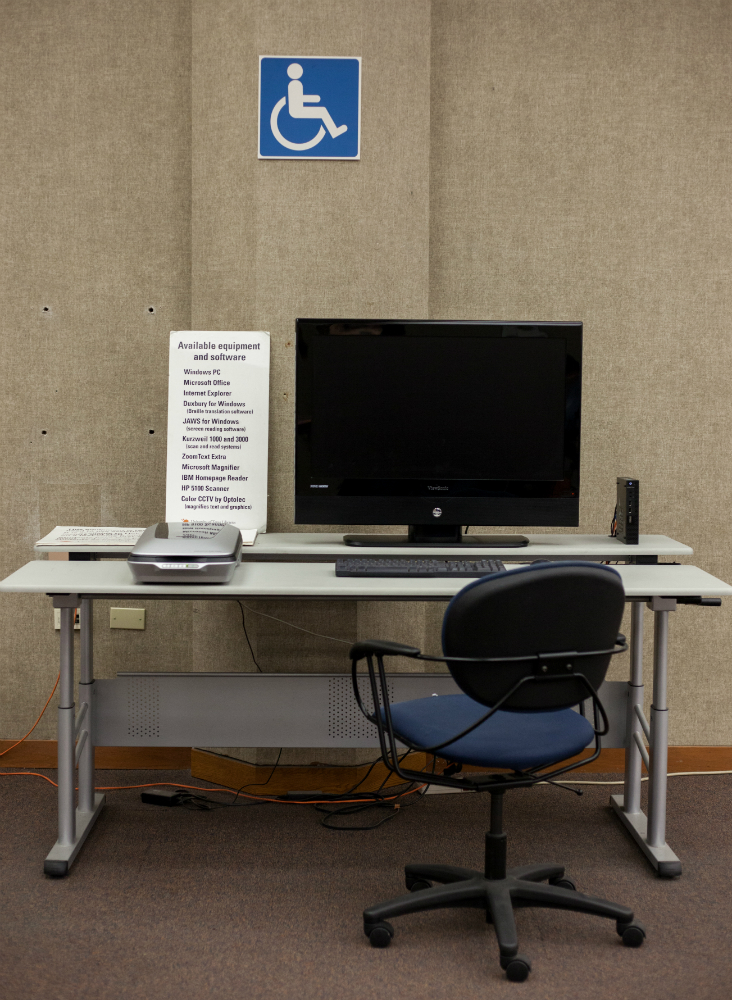 Image of a workstation with assistive technology equipment at PCL.