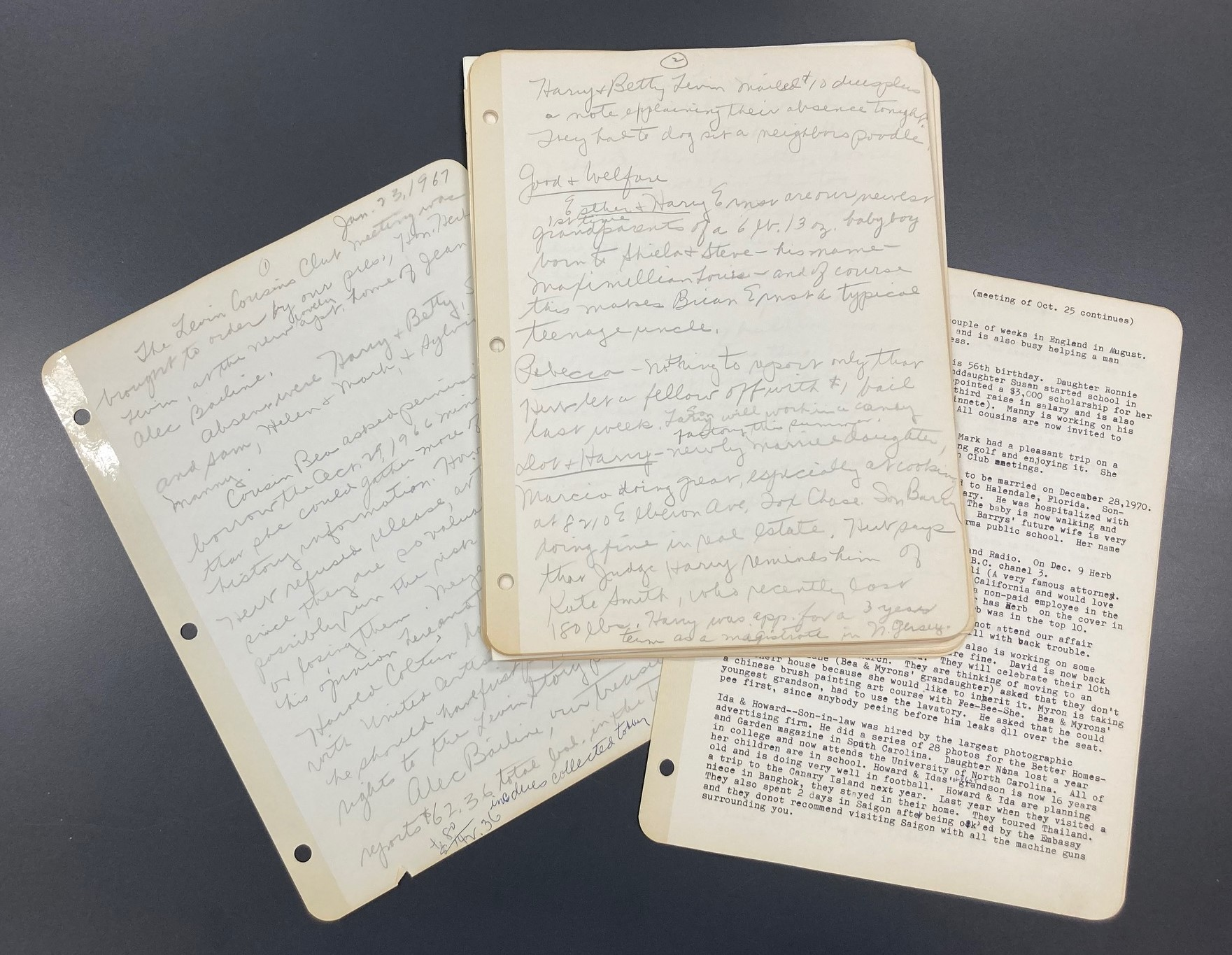 Handwritten and typed papers arranged on a gray background