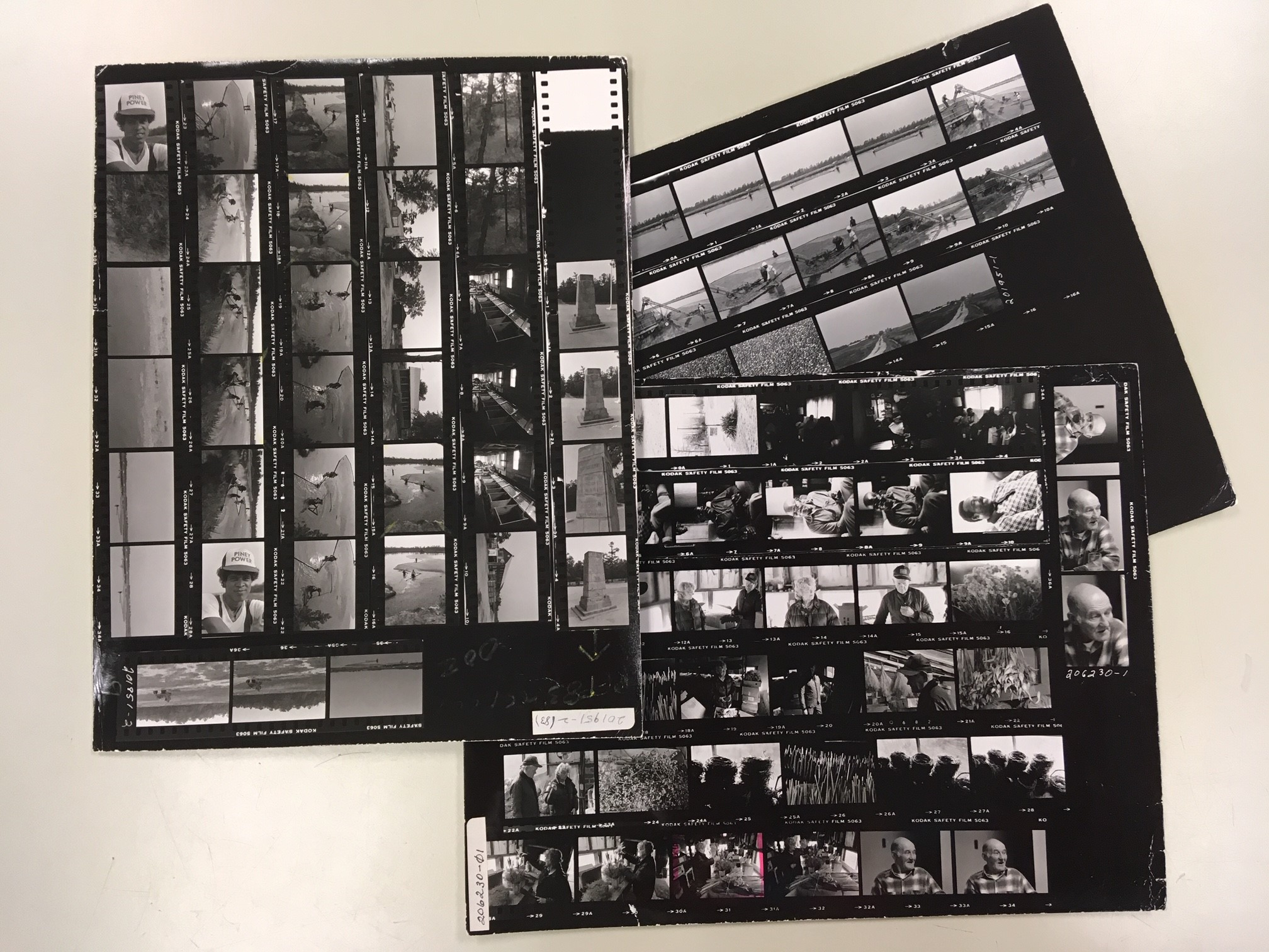3 photograph contact sheets with many small images